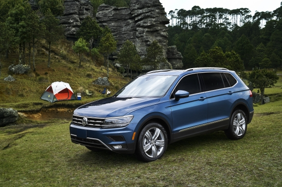 A blue 2019 Volkswagen Tiguan parked out in nature
