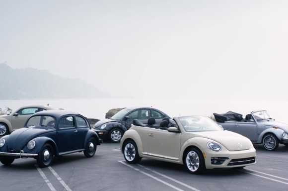 1949 Volkswagen Beetle, 1979 Volkswagen Super Beetle, 1998 Volkswagen New Beetle, & 2019 Volkswagen Final Edition Beetles